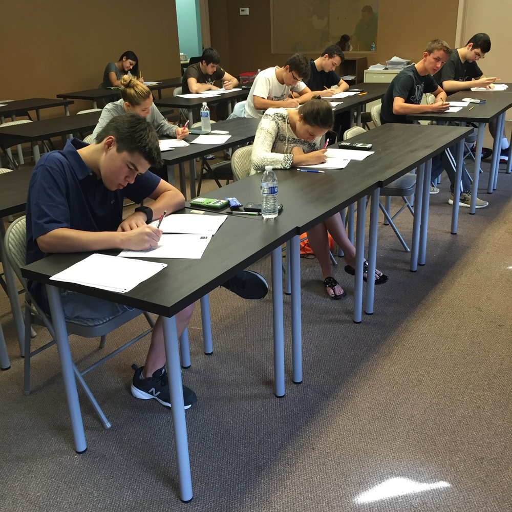 Students taking a practice SAT at Foley Prep